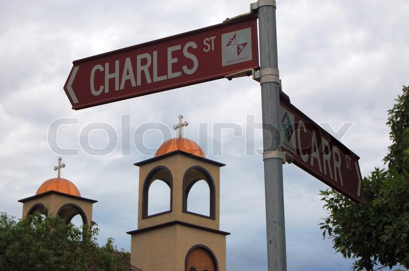Road sign and church, stock photo