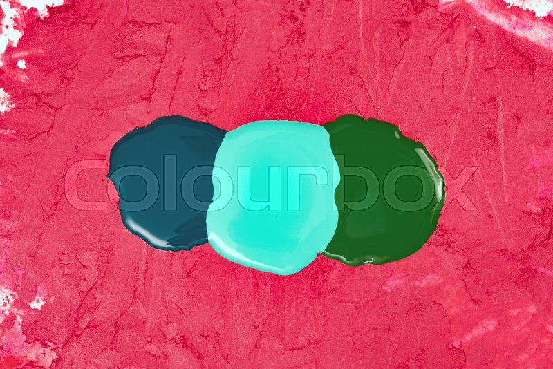Abstract makeup background of colorful nail varnish on a lipstick texture. Top view, stock photo