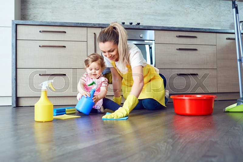Mother And Baby Are Cleaning The House. | Stock Image | Colourbox