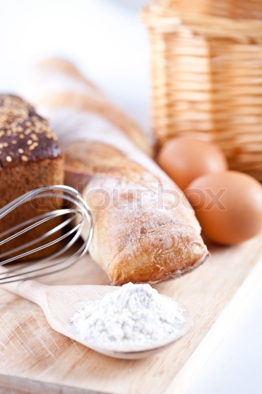 Amazing Still Life Of Bread, Flour, Eggs And Kitchen Utensil On A Wooden Board,  Stock Photo