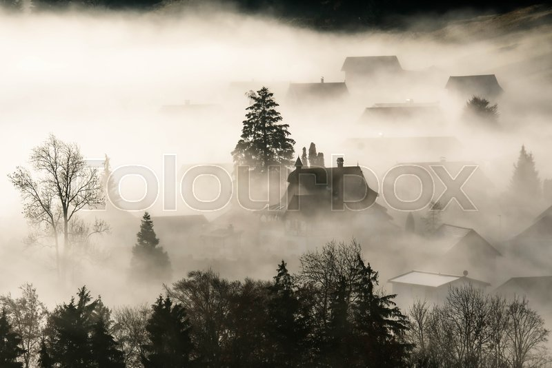 Stock image of 'Foggy morning in a small village'