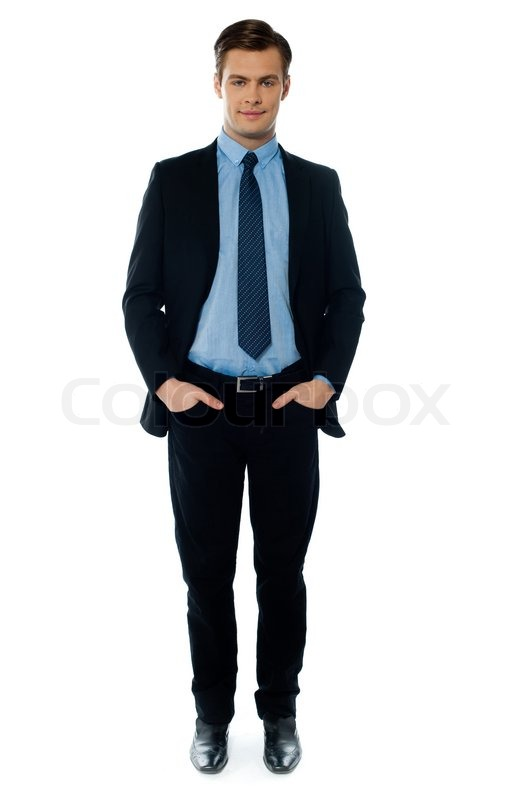 young businessperson posing with hands in pocket stock
