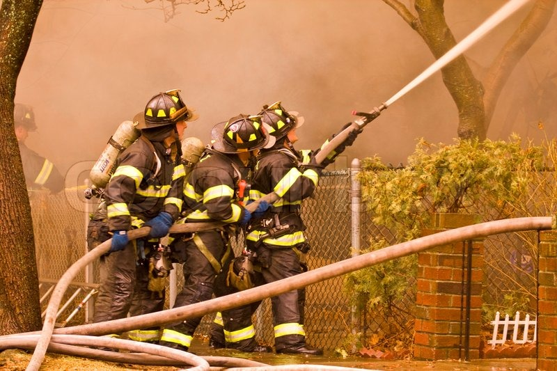 firemen at work putting out a house fire stock photo colourbox