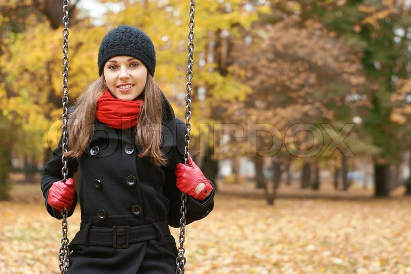 0adabd9020 A happy woman in autumn clothes on a ...
