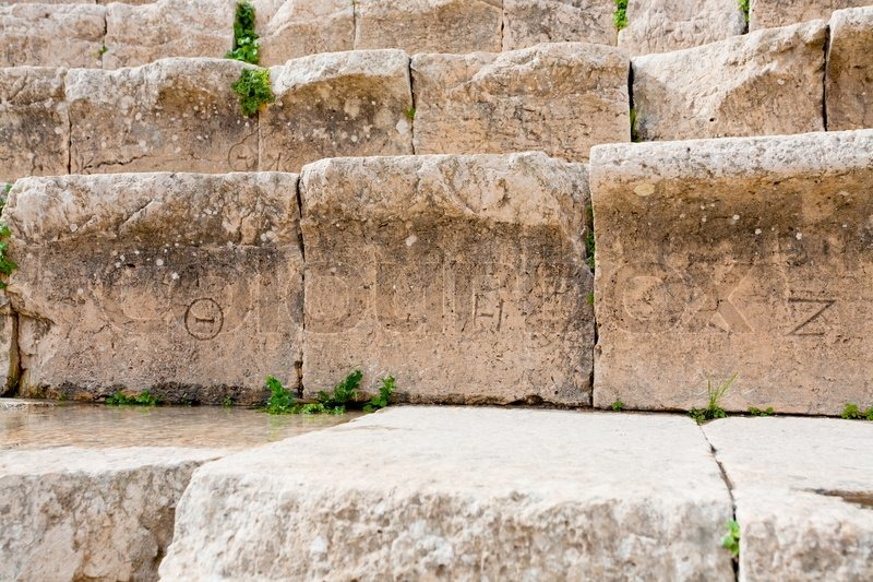 Ancient Greek Numbers On Stone Seats In Stock Photo