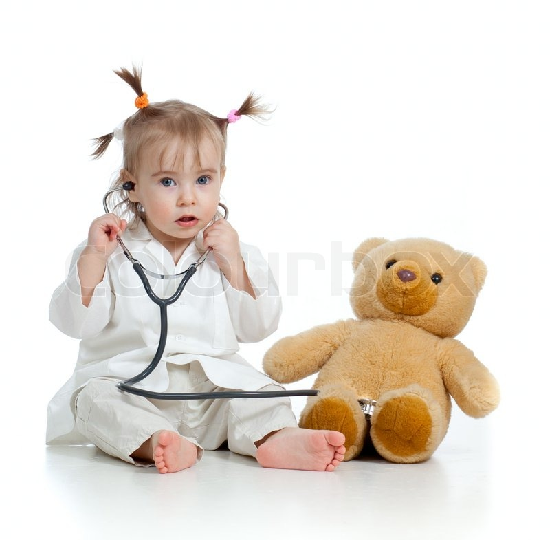 Adorable child with clothes of doctor and teddy bear over