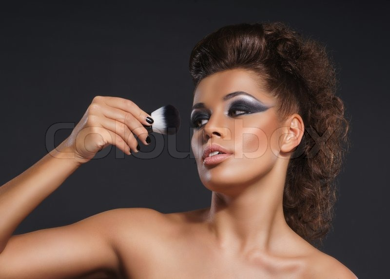 Stock image of 'Portrait of young attractive woman in makeup concept'