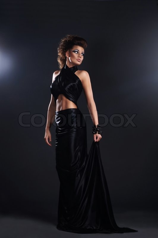 Woman In Black Long Dress Over Dark Stock Photo Colourbox