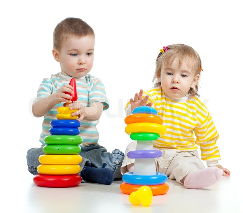 two little children playing with color toys stock photo