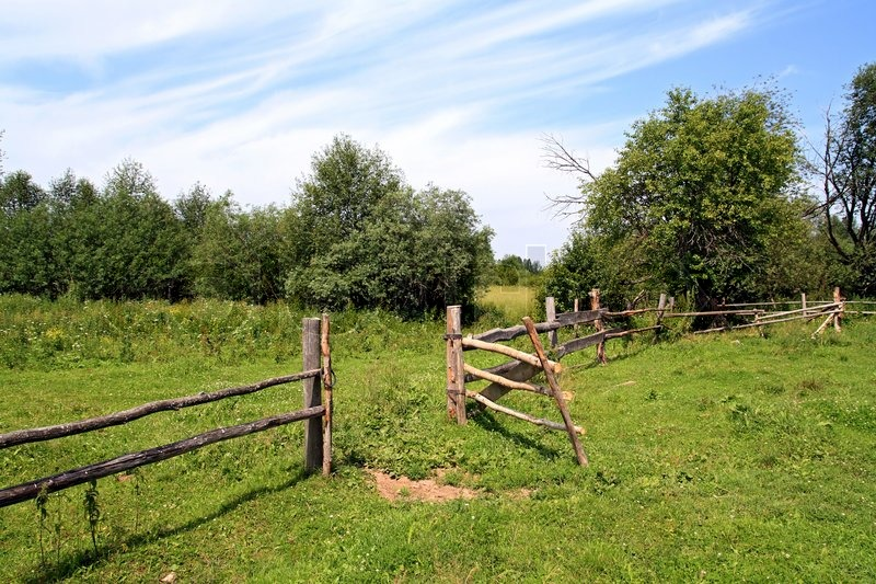 Wooden Fence On Green Pasture Stock Photo Colourbox