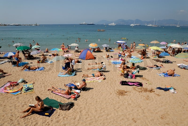 people on the beach in cannes southern france stock photo colourbox