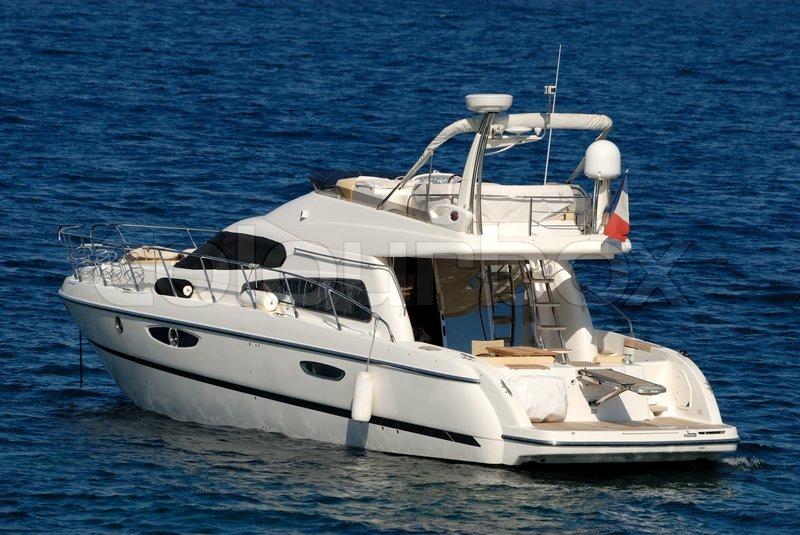 Small Luxury Motor Yacht In The Mediterranean Sea Stock Photo