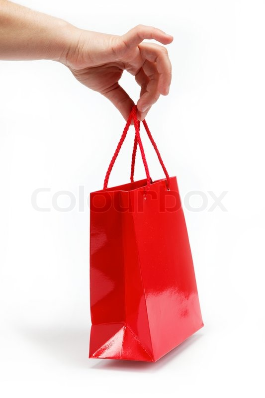 Red gift bag in the women s hand on a white background