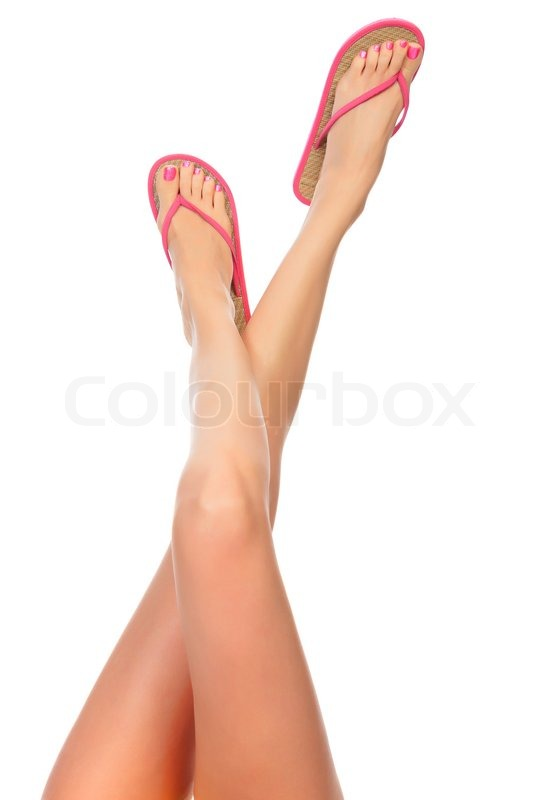 7a725493e023 Stock image of  Female legs with pink flip-flops
