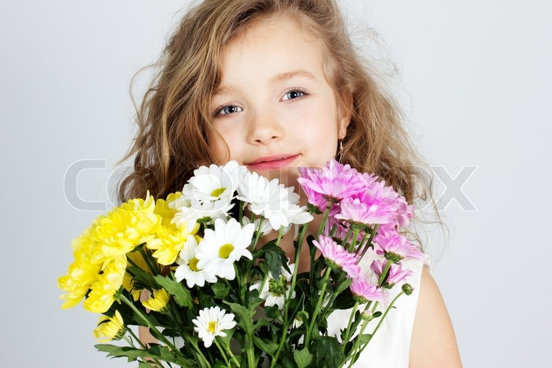 Portrait Of A Beautiful Little Girl With Flowers Stock