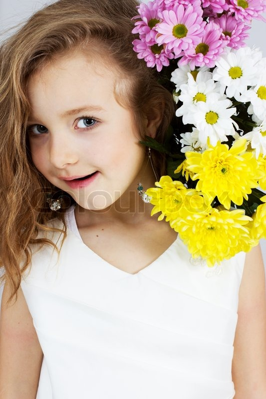 Cute Small Girl Cute Little Girl With Flowers  Stock Photo  Colourbox