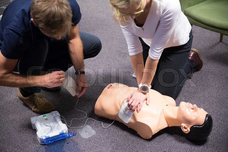First aid cardiopulmonary resuscitation course using automated external defibrillator device, AED, stock photo