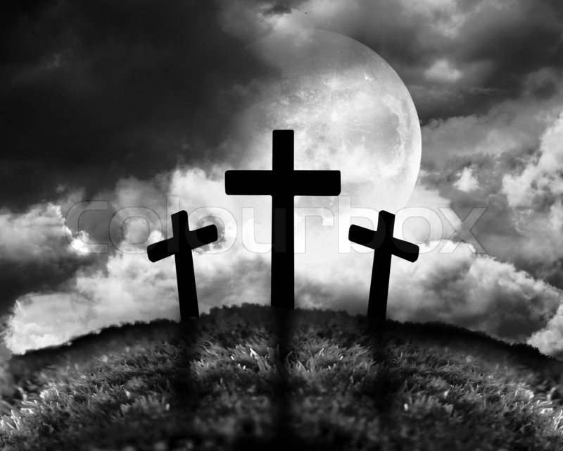 Silhouette of three crosses on a hill, stock photo