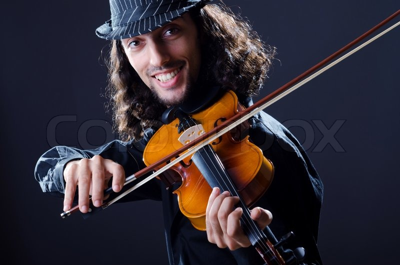 Stock image of 'Gypsy violin player in studio'