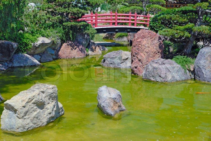 Japanese red bridge in zen garden stock photo colourbox for Zen garden bridge