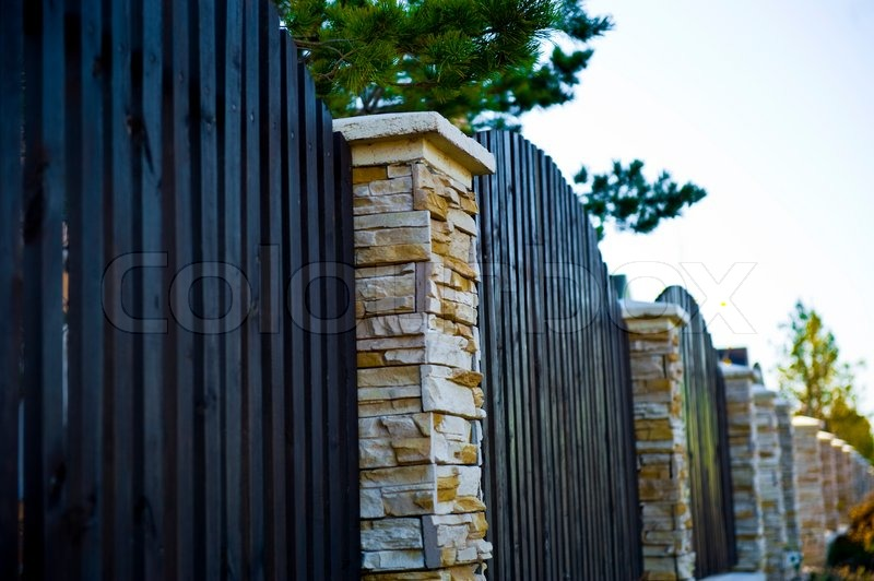 decorative fence with columns stock photo - Decorative Fence