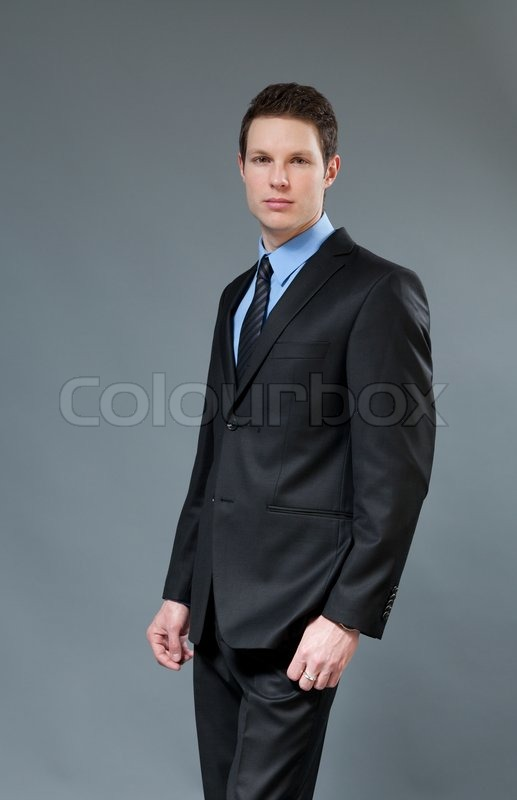 24fa32df Young businessman wearing classic dark ... | Stock image | Colourbox
