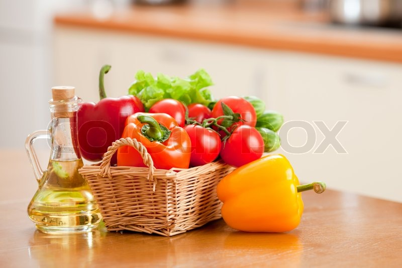 Kitchen Table With Food healthy food fresh vegetablesand bottle with oil on the kitchen
