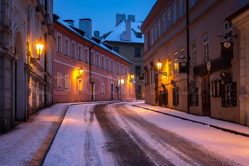 Empty street in winter Prague, Czech Republic. City covered with fresh snow, stock photo