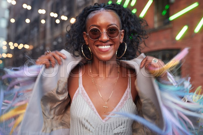 Trendy woman in striped camisole and fringed jacket, stock photo