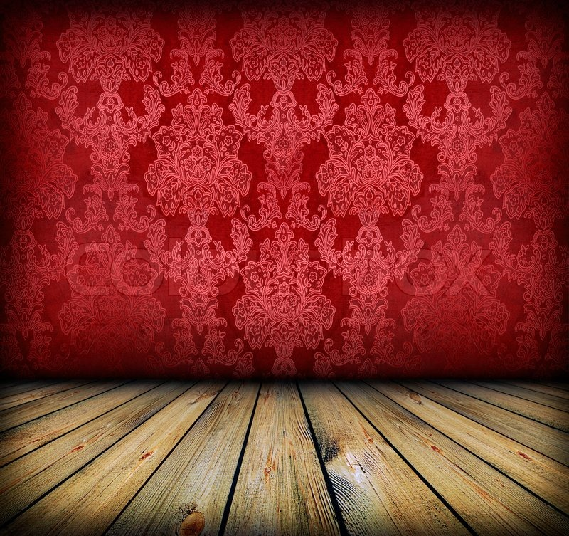 dark vintage red room with empty frame hanging on the wall | stock
