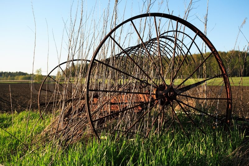 Antique Spike Harrows : Old rusty agricultural harrow on springy field stock