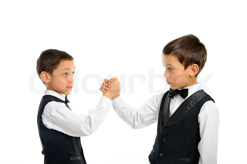 Stock image of 'Twins playing arm wrestling isolated'