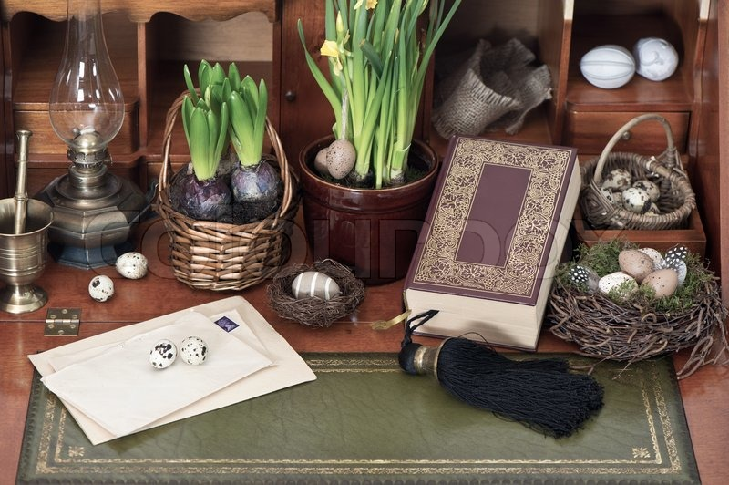 Stock image of 'Old bible book with easter eggs and vintage things'