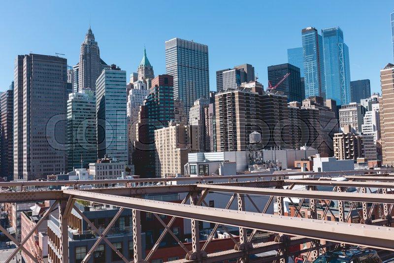 Urban scene of manhattan from brooklyn bridge in new york, usa, stock photo