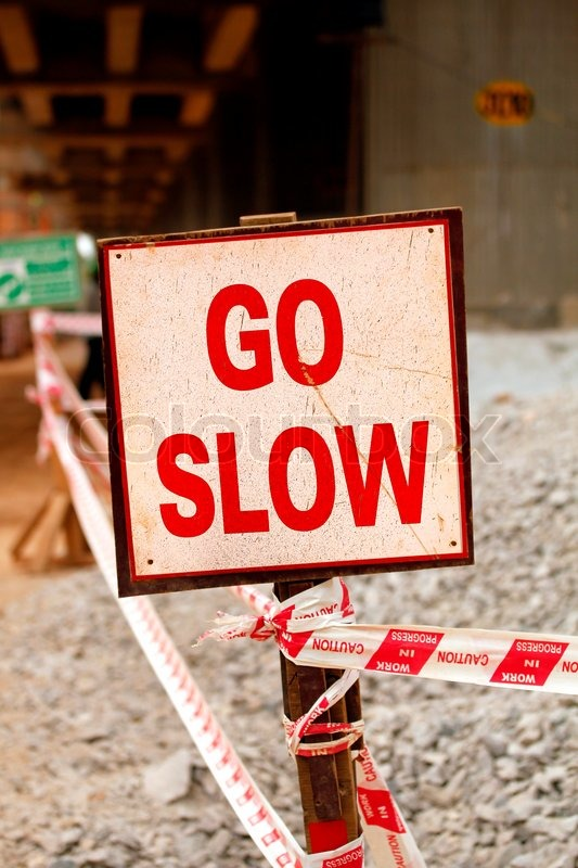 Stock image of 'Go slow sign board'