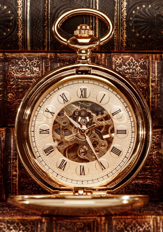 Stock image of 'Antique clock dial close-up. Vintage pocket watch.'