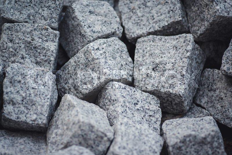 Heap of grey square stones, stock photo
