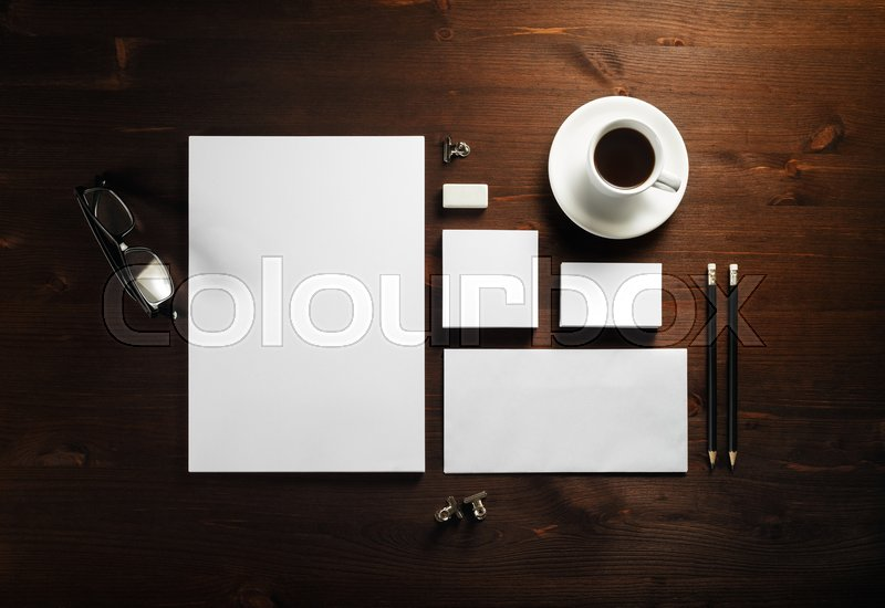 Photo of blank corporate stationery set on wooden background. Template for branding identity. Branding mock up. Flat lay, stock photo