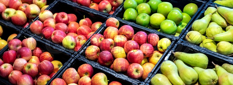 Orchard product fruit banner. Grocery supermarket store. Shelves with variety of different orgnaic fresh ripe pears and apples. Vegetable and fruit market, stock photo