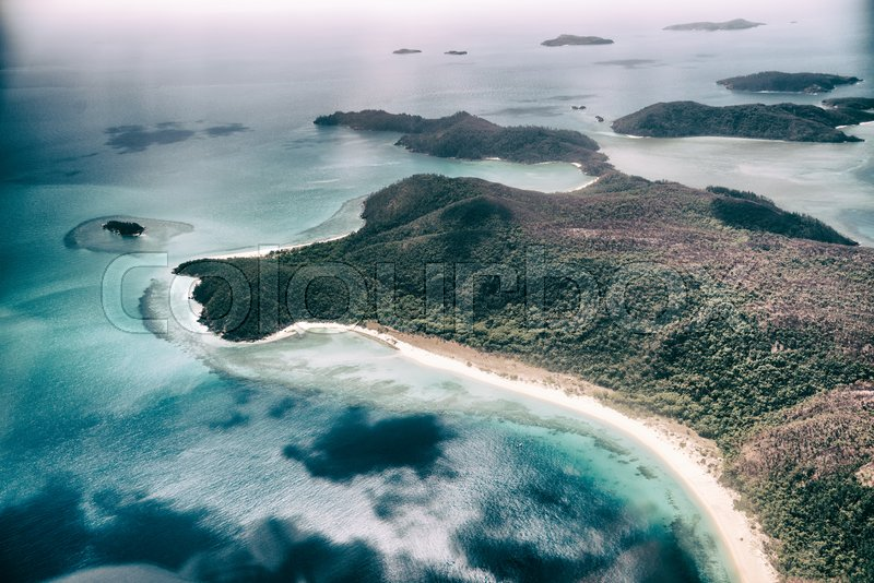 Aerial overhead view of Whitsunday Archipelago on a beautiful sunny day, Australia, stock photo