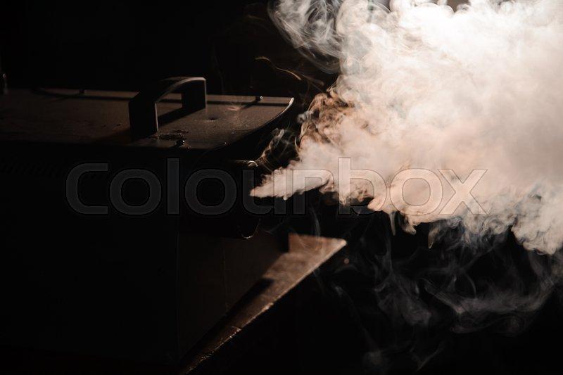 Lights in smoke, studio lights shining through the smoke from smoke machine, stock photo