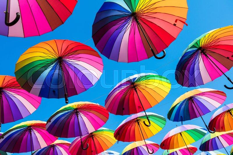 Many colorful umbrellas. Rainbow gay pride protection, stock photo