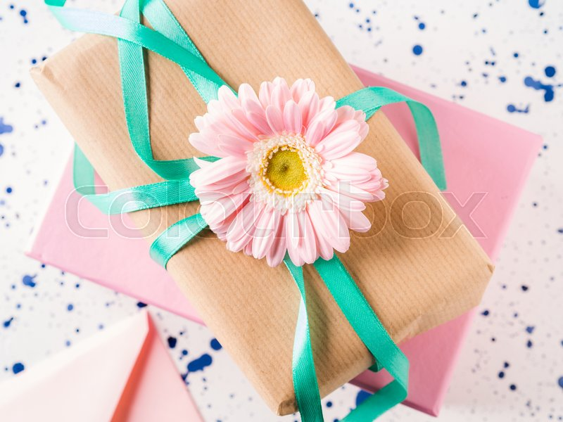 Stacked gift boxes with flowers. Pastel colors. Woman, mother, Valentine day greeting card. Event invitation, stock photo