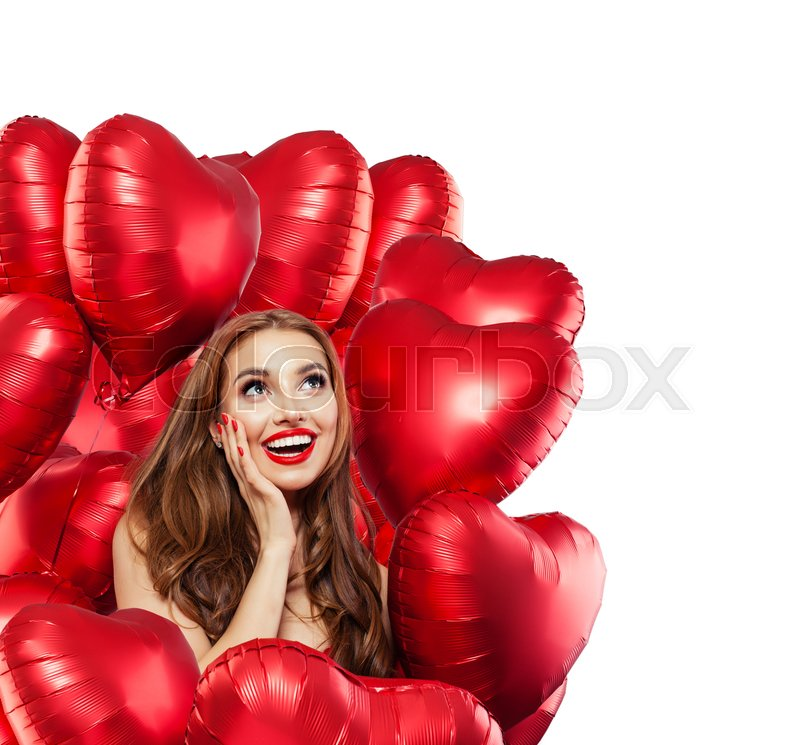 Happy surprised woman with red balloons isolated on white background. Surprised girl with red lips makeup smiling and looking up. Surprise, gifts and Valentine\'s day ..., stock photo