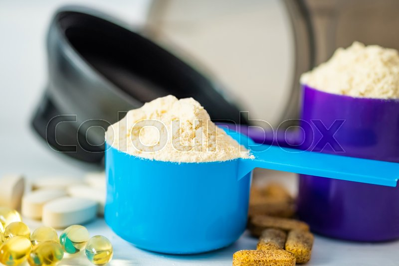 Sport food supplements. Sport Pills, vitamins and protein powder on the white table, stock photo