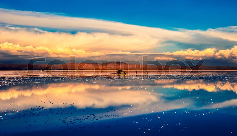 Stock image of 'Amazing Salar de Uyuni mirror surface scenery with tourists and cars'