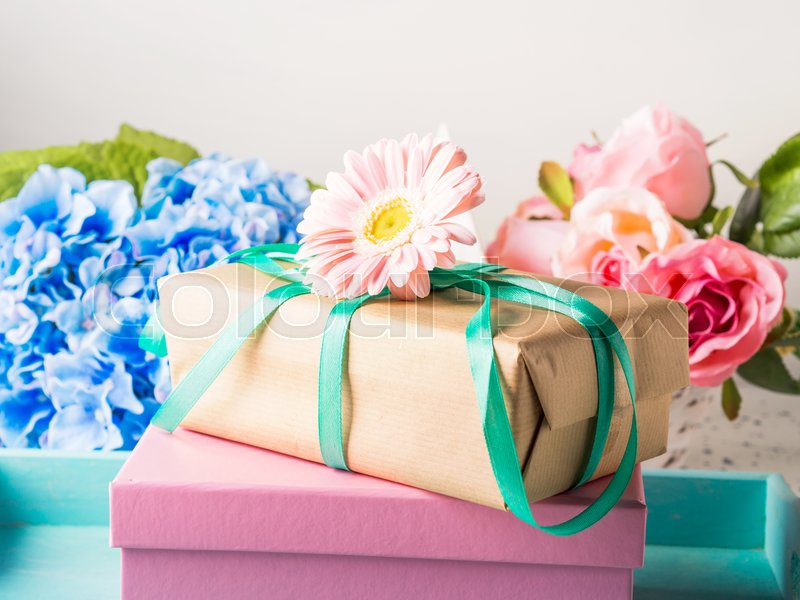 Stacked gift boxes with flowers. Pastel colors. Woman, mother, Valentine day greeting card, stock photo