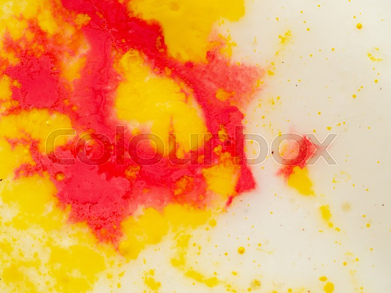 Yellow red pattern on bright background. Close up shot. Abstract background. Colourful abstract pattern of yellow and red paint. Paint splashes. Macro shot. Blurred ..., stock photo