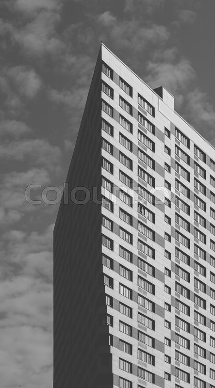 Black and White Skyscraper on the Cloudy Sky Background, stock photo
