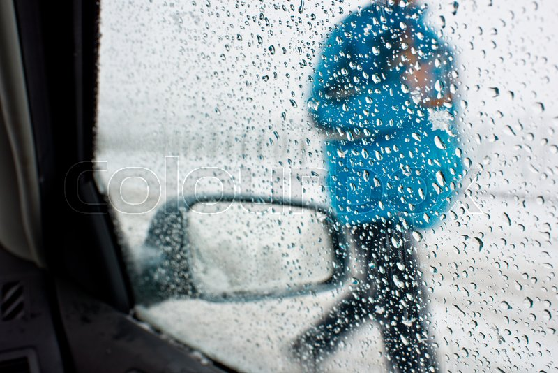 Detail of rear-view mirror in the rainy weather, stock photo